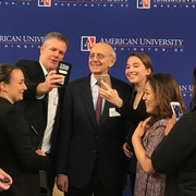 Associate Justice Breyer taking selfies with students.