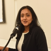 Vanita Gupta, Principal Deputy Assistant Attorney General at the DOJ, giving a keynote speech