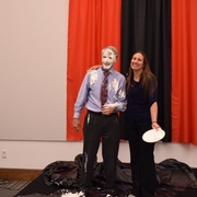 Professor Paul Figley gets pied by a student, who won the bid